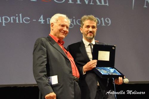 Walter Fasano premiato da Roberto Perpignani