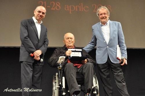 Il regista Bernardo Bertolucci tra Giuseppe Tornatore e Felice Laudadio